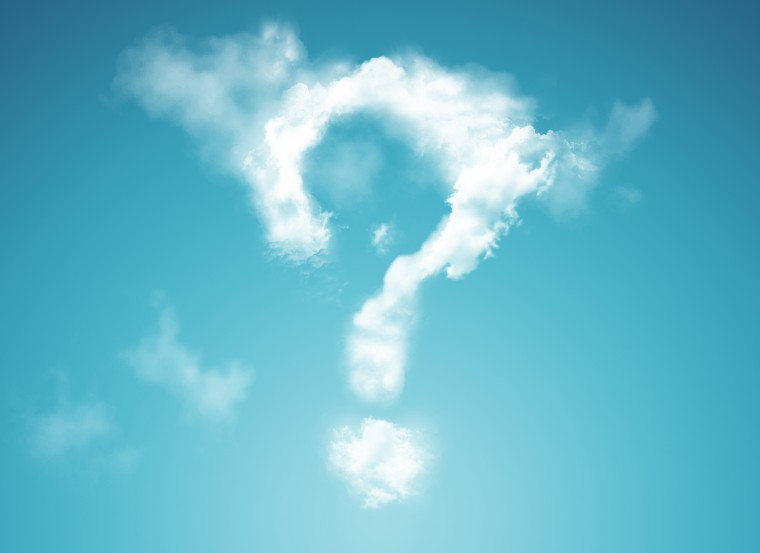 casual young man looking at a big question mark made of clouds